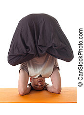 Yoga headstand posing by middle aged man - Shot of yoga...