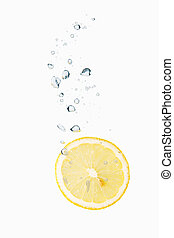 Lemon in water with air bubbles