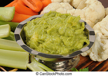 Veggies and guacamole dip - Fresh cut carrots, celery sticks...