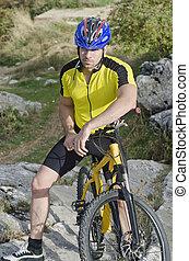 Mountain Biker - Mountain biker posing in outdoors image