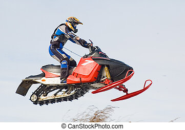Flying sportsman on snowmobile - Competition of snow mobile...