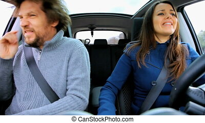 Having fun dancing in car - Couple in moving car dancing and...