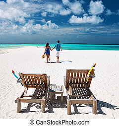 Couple running on a beach at Maldives - Couple running on a...