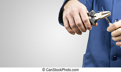 Workman repairing an electrical cable - Workman or...