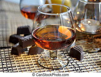 Brandy and sweet - Brandy in glass and sweet chocolate