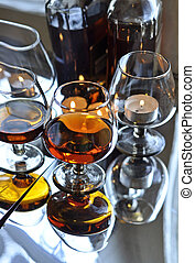 Brandy and candles - a glass of brandy and candle