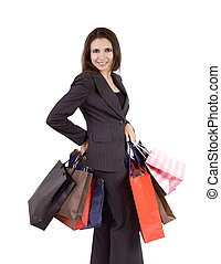 Woman with shopping bags - A young business woman with a lot...
