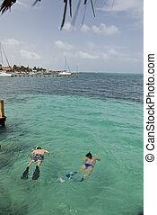 Snorkling at Ramon`s - Two people snorkel off the dock at...