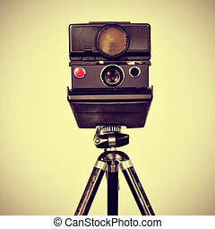old instant camera in a tripod - picture of an old instant...