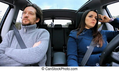 Wife angry with husband in car