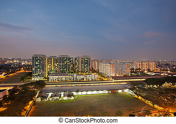 Singapore Housing Estate by MRT Train Station at Dusk