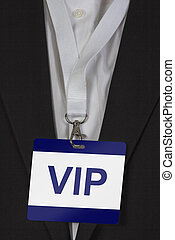 VIP Pass - man in suite wearing a VIP pass arround his neck