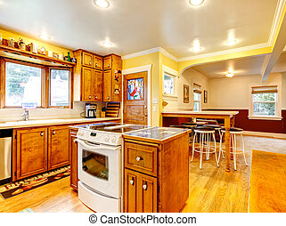 Kitchen room design idea - Bright kitchen with rustic wooden...