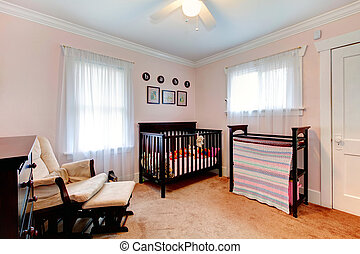 Cozy nursery room - Bright nursery room with light pink...