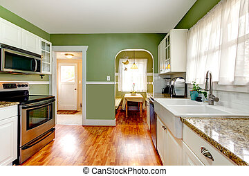 Green kitchen room with dining area