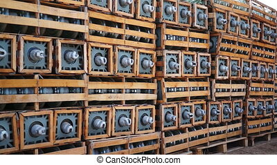 Electrical Insulators on Pallets Do - Dolly shot of many...