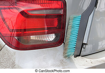dirty car with a brush