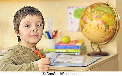 boy  doing homework in his room