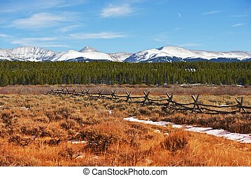 Majestic Colorado Landscape in Autumn with Snowy Peaks...