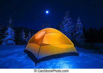 Winter Tent Camping in Colorado Wilderness. Cold Snowy High...