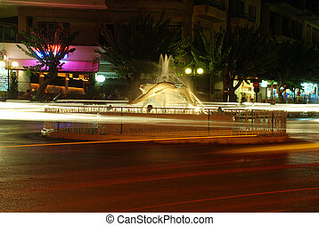 Fountain at night and trafic with long exposure