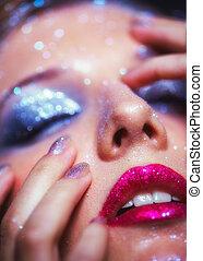 Shining woman face makeup - Low depth of focus portrait of...