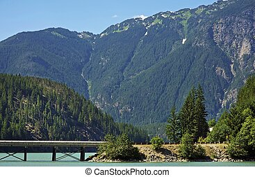 North Cascades Mountains Landscape with Bridge on the Lake....