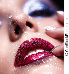 Shining woman lips makeup - Low depth of focus portrait of...