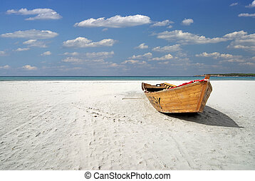 Ship on the beach - Wooden fishing boat on the white beach