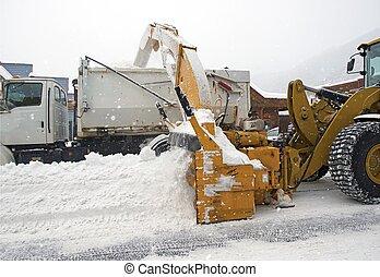 Street Snow Removal by Heavy Equipment. Colorado Snow...