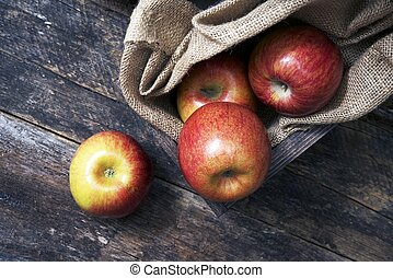 Organic Apples on Wood. Fresh Apples in Wooden Crate with...