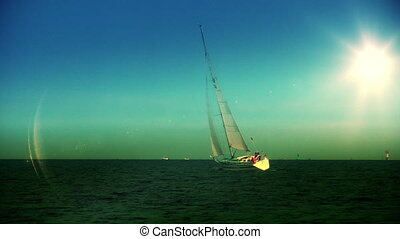 Yacht sailing at sundown