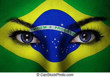 Brazil woman face - Woman with Brazil flag painted on her...