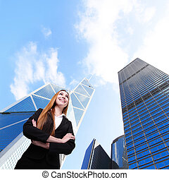 Business woman smile with office building - Business woman...