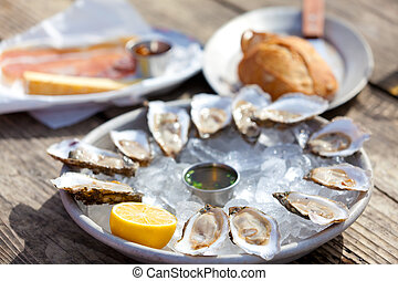 raw oysters - fresh raw open oysters on ice and other snacks...