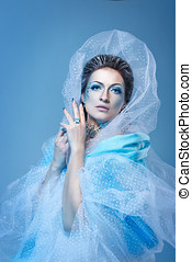 Snow Queen - Attractive young girl with a theatrical makeup...