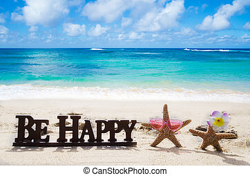 "Sign ""Be Happy"" on the sandy beach with starfishes"