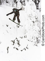 Snowboarder Jumping off Of Cliff