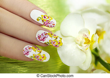 Nail extension with orchids. - Nail with a pattern of...