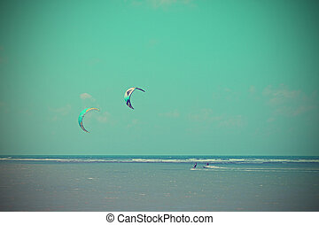 Kitesurfing in sunny day with blue sea and sky on Samui...