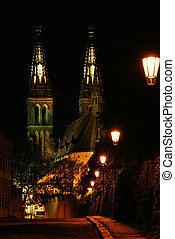 Road with lanterns and a cathedral