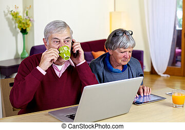 Senior man drinking coffee while on the phone