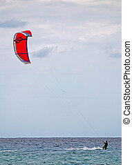 Kite surfer is enjoying windy weather on Sardinia