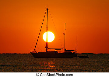Sunrise and boat - Sailing boat silhouette and golden...