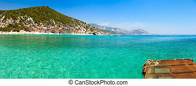 Clear turquoise water of Cala Luna in Sardinia - Panoramic...