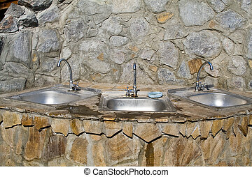 washstand on a background a stone wall