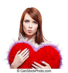 girl holding fur red heart