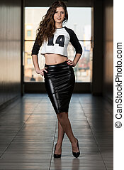 Beautiful Woman Wearing Black Leather Skirt - Portrait Of...