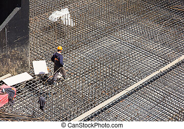 workers make reinforcement for concrete foundation