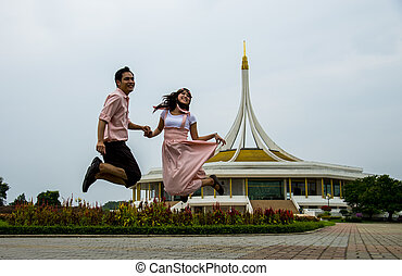 Lovely couple jump up together2
